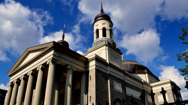 Baltimore Maryland - July 23 2013: The imposing Baltimore Basilica built in 1821 with its neo-classical Greek west front the first Catholic cathedral built in the USA