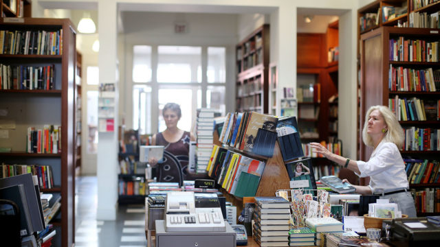 - Charlottesville, VA - 7/28/15 -   Owner Carol Troxell arranges books at New Dominion Bookshop (winner, Independent Bookstore for Best of C-Ville).  Credit:   Amanda Maglione Location: New Dominion Bookshop Filename: NewDominion017
